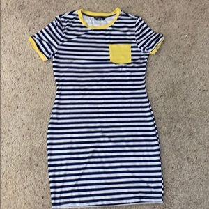 This is a navy blue and yellow tight dress.